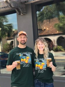 Courtney and Eric Boettcher enjoying 2020 Loquat Beer at the Cotee River Brewing Company, April 2020
